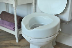 Serenity Raised Toilet Seat Range- NEW: 4 inch model with lid fitted